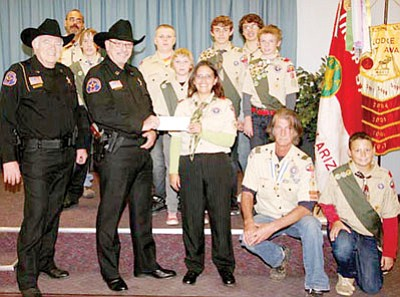 "Arizona Rangers Hank Hellman, left, and Captain Dave Kyburz present a check for $500 to Scoutmaster Felicia Robinson of Boy Scout Troop 57 of Prescott Valley, the only ""special needs"" troop in Northern Arizona. Back row from left: Robert Henning, Sr., Kyle Brewer, Joe Beckering, Chase Doyle, Robert Henning Jr. Middle row: Josh Rosson and Mathew Ravelli. Front row: Hellman, Kyburz, Robinson, Brian Bramley, and Dawson Gillen.<br> Courtesy Photo/Yvonne Hellman"