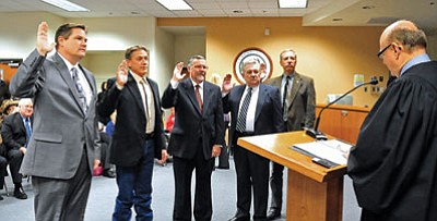 Judge David Mackey swears in County Supervisors Jack Smith, Chip Davis, Rowle Simmons, Craig Brown and Tom Thurman Tuesday morning at in Prescott.<br> Photo courtesy Matt Hinshaw