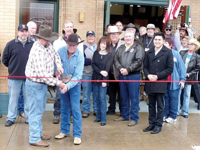 Nearly 200 people showed up in drizzly weather Saturday to participate in the Dewey-Humboldt Historical Museum grand opening ceremonies, complete with the ribbon-cutting efforts of D-H Historical Society Vice President John Young, left, and D-HHS President Kevin Leonard.<br> Courtesy Photo
