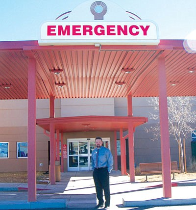 John Amos, chief operating officer at the East Campus of Yavapai Regional Medical Center in Prescott Valley, stands outside the new entrance to the emergency department, which is undergoing a major expansion.<br> Photo courtesy Ken Hedler