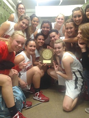 The Bradshaw Mountain girls basketball team pose Saturday night with their sectional tournament championship trophy. With 29 straight wins, a tournament title, a first-round bye at state, and home court advantage, they are on fire.<br> Courtesy photo