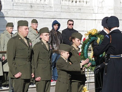 Young Marines from left LCplD. Lindquist, Prescott Valley; SSgtM. Reveile, Prescott; CplI. Watson, Chino Valley; and LCplK. Bray lay a wreath at the Tomb of the Unknown Soldier at Arlington National Cemetery, Virginia.<br> Courtesy Photo