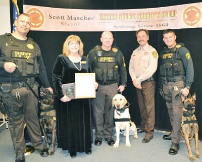 "From left, Deputy Jarrod Winfrey with ""Tjando,"" YCCF Co-chair Sharon Block, Sgt. Jeff Jaeger with ""Bo,"" Sheriff Mascher, and Deputy Eric Lopez with ""Miley."""