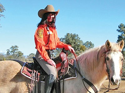 Carol (last name withheld per request) and trusty horse Sequel are ready for a Search and Rescue operation as part of the Yavapai County Sheriff's Response Team's Mounted Unit.<br> Courtesy Photo