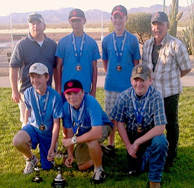 The Prescott Bird Busters trapshooters recently competed in the state championships at the Tucson Trap and Skeet Club and earned the state title and first place and the 2013 Trap Commissioners Cup. Front row, from left, are: Lewis Aul, Prescott Mile High Middle School; Jakob Woods, Acorn Montessori School; and Colton Underwood, home-schooled. Back row are: Coach Jake Underwood; Austin Reynolds, Bradshaw Mountain Middle School; Luke Poteat, Bradshaw Mountain Middle School; and Coach Greg Utech.<br> Courtesy Photo