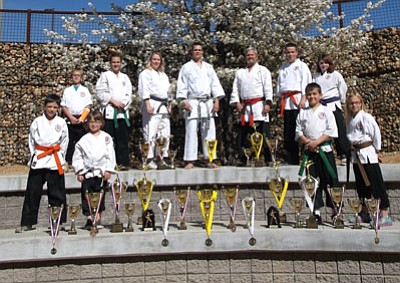 From left, top row: Fisher Plucinsky-2nd Team Kata, 2nd Chambarra, 3rd Koshiki, Mackenzie Donovan-1st Chambarra, 2nd Koshiki, 3rd Kobudo, Renshi Lori Morris-1st Chambarra, 2nd Kata, 3rd Kumite, Shihan Alex Morris-1st Kumite, 1st Chambarra,2nd Kata, 2nd Musical Kata, 3rd Kobudo, Kyoshi james Morris, Jake Duchesne-2nd Kumite, 3rd Chambarra, 4th Kobudo, 4th Kata, Danielle Hamilton-2nd Chambarra, 3rd Musical Kata, 3rd Koshiki, 4th Kobudo. Bottom row- Cosmo Morris-2nd Musical Kata, 4th Kumite, Makenzee Morris-1st Musical Kata,3rd Chambarra, 3rd Kumite, Dylan Donovan-2nd Team Kata, 3rd Team Sparring, 4th Chambarra, 4th Koshiki, Ceiley Plucinsky-1st Chambarra, 2nd Team Kata, 3rd Koshiki, 3rd Team Sparring, 3rd Kata, 3rd Kumite, 4th Kobudo. Not pictured: Memphis James-3rd team Sparring.<br> Courtesy Photo