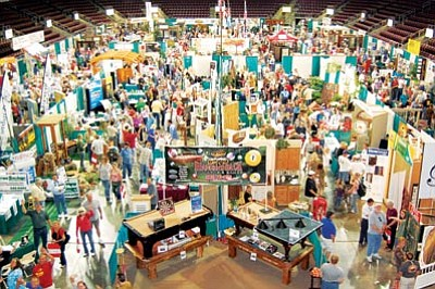 Attendees and vendors fill Tim's Toyota Center in Prescott Valley at a previous Yavapai County Contractors Association Home & Garden Show. This year's event runs today through Sunday.<br> Sandy Griffis, YCCA/Courtesy photo