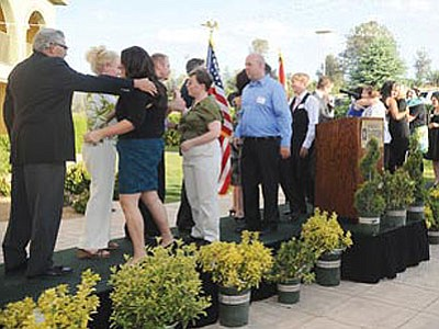 The first 14 graduates from the Northern Arizona University/Yavapai program thank faculty and staff at a reception at the Wyndham Garden Hotel Friday.<br> Photo courtesy Les Stukenberg/The Daily Courier