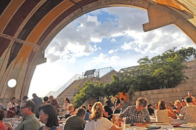 Guests dine under the vault at a past Arcosanti Italian Night. Guests will miss founder Paolo Soleri serving pasta from a wheelbarrow, but memories of the renowned architect are sure to be the topic of the evening's conversation.<br> TribFile/Heidi Dahms Foster