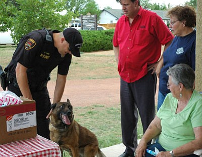 Prescott Valley K9 Officer Paul Hines introduces his dog Joey during a past National Night Out. Joey now is retired with Hines, and this year, National Night Out participants will see Hines with his new K9 partner Kio.<br> FilePhoto/Cheryl Hartz