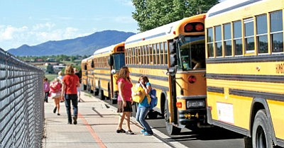 Buses line the bus-only lane for dropping off students on the first day of school at Coyote Springs Elementary School in 2009.<br> TribFile/Sue Tone