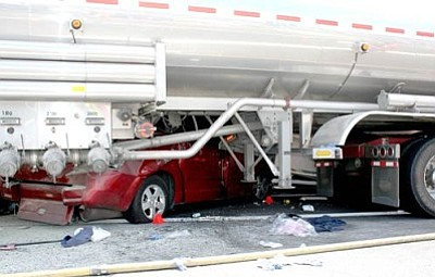 This minivan was crushed under a tanker truck July 31 in Prescott Valley when a truck and trailer overturned. <br>TribPhoto/Sue Tone