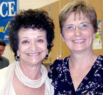 MVES Principal JoAnne Bindell, right, honors JoAnn Hayden, extended resource teacher.<br> TribPhoto/Sue Tone