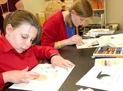 Amanda Schuler, left, and Charlotte Ryan work on an afterschool art project in pastels led by PV artist Mei-June Liao Aug. 21 at Liberty Traditional School.<br>  TribPhoto/Sue Tone