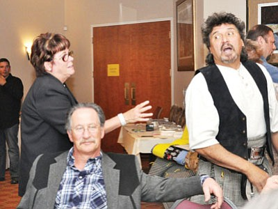Seamus O'Malley (Mike Shepard) tries to escape the attentions of PR research analyst Irma Snell (Jean Lupa) during the 2012 Prescott Valley Police Foundation Mystery Dinner.<br> TribPhoto/Heidi Dahms Foster