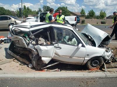 Investigators work the scene of a 6-vehicle crash Saturday on Glassford Hill Road in Prescott Valley.<br> Photo courtesy PVPD