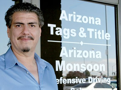 Anton Teschner owns and operates Arizona Tags & Title now in the Prescott Valley Plaza Shopping Center.<br> TribPhoto/Sue Tone