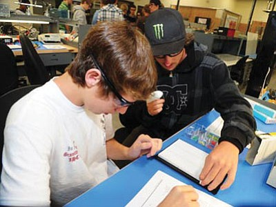 Don Stagg from Bradshaw Mountain and Corey Cain from Ash Fork work on a lab project in a digital circuits class that is part of Yavapai College's JTED Mountain Institute Applied Pre-Engineering program.<br> Photo courtesy Les Stukenberg/The Daily Courier