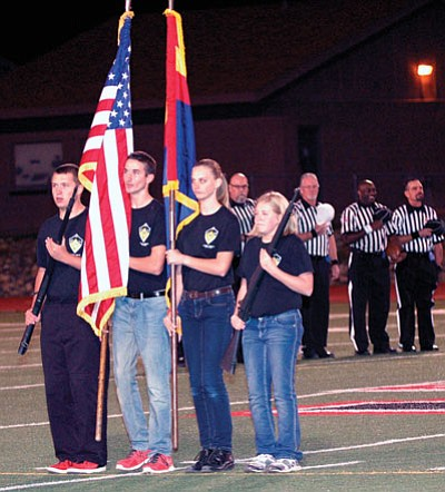 For the first time, Bradshaw Mountain JROTC Color Guard presents the colors during Homecoming.<br> TribPhoto/Cheryl Hartz