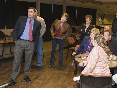 Humboldt Unified School District public education supporters look on in dismay at the results of the vote for a budget override Tuesday night.<br> Photo courtesy Les Stukenberg/The Daily Courier