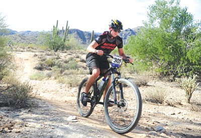 Bradshaw Mountain's Josh Miller had the best finish of the year for the BMHS boys' team by finishing 16th at the Arizona High School Cycling League's final race at the White Tank Regional Park in Waddell recently.<br> Trib Photo/Les Stukenberg