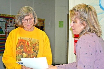 Dewey-Humboldt resident Nancy Wright signs in for an EPA public meeting and open house and receives answers to her questions from ADEQ Community Involvement Coordinator Wendy Flood. The meeting was about the Superfund's remedial clean up efforts.<br> Trib Photo/Briana Lonas