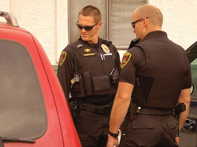 PVPD officers examine one of the cars opened overnight. Nothing of value seems to have been taken.<br> Photo courtesy Scott Orr/ The Daily Courier