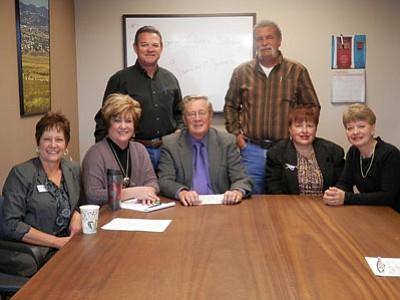 Pictured are Arizona State Credit Union's Donna Laxson, Prescott Valley Chamber of Commerce CEO Marnie Uhl, Premier Development's Ron Owsley, Mayor Skoog, Asphalt Paving and Supply's Chris Graff, Pathfinder Ranch/Bully Free Zone's Georia Benyck, and Ponderosa Hotels' Cecelia Jernigan.