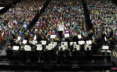 Paul Manz conducts the Prescott Pops Symphony Orchestra as they play for more than 4,000 students at the 38th annual Music Memories concert Tuesday at Tim's Toyota Center in Prescott Valley.<br> Photo courtesy Les Stukenberg/The Daily Courier