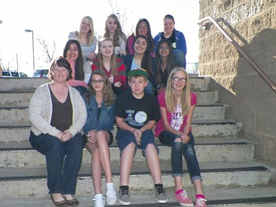 At right, some Glassford Hill Middle School yearbook students pose  at the school's entrance. Top row from left are:Miah Devine, Jacquelyn Bassford, Diana Mendez, Delanie Clark; middle row: Myrian Nolasco, Olivia Keating, Airam Valenzuela, Hennessy Villa; bottom row: advisor Mrs. Diana Campell, Makena Brooks, Bailey Lame, Rylee Bundrick.  Not pictured: Nikala Calia, Carmen DeAlba, Serena Pelaez<br> Courtesy Photo