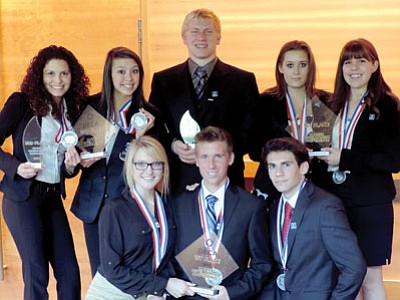 Bradshaw Mountain High School DECA students show off their awards at the State conference in March. Kneeling, from left, are Hayley Ehresman, Hunter Powell and Josh Lewis. Back row, from left, are Alondra Castillo, Darcie Hill, Evan Wood, Meghan Belsito and Athena Bowman.           <br> Courtesy Photo