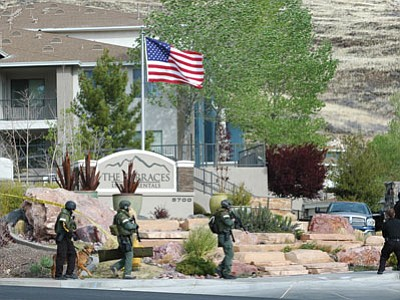 Prescott Valley Special Weapons and Tactics officers surround an apartment complex Wednesday morning after receiving a call about an alleged home invasion.<br> Cheryl Hartz/Prescott Valley Tribune/Courtesy photo