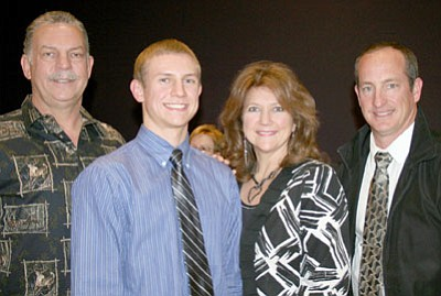 Bradshaw Mountain High School Student of the Month, Tyler Silva, second from left, appears with his parents, Larry and Melinda Silva, and BMHS Principal Kort Miner, right, at the Prescott Valley Town Council meeting on March 27.<br> Trib Photo/Sue Tone