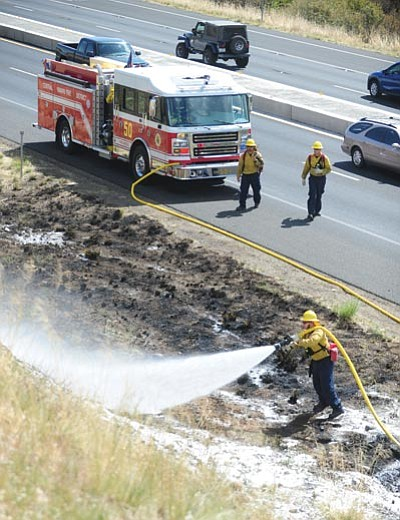 Central Yavapai Fire District personnel put out hot spots at one of four wildland fires that flared up along Highway 69 between Prescott and Prescott Valley Thursday morning.<br> Photo courtesy Les Stukenberg/The Daily Courier