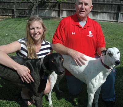 Patrick Whitehurst/The Daily Courier<br> Prescott Valley couple Donald and Jamie LaRueare pictured at their home in Prescott Valley with their adopted greyhound dogs. The two began dating while serving in Iraq. Both were injured in combat during their deployment in 2003.