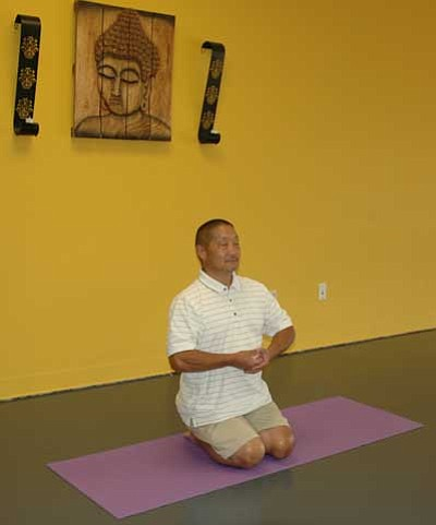 Trib Photo/Briana Lonas<BR> Key Matsuda takes a break to meditate at a self-guided meditation Meetup.