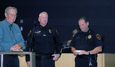 Trib Photo/Briana Lonas<br> From left, Mayor Harvey Skoog, and right, Police Chief Bryan Jarrell honor PVPD Commander Art Askew, center, last week on his 20 years with the Prescott Valley Police Department.