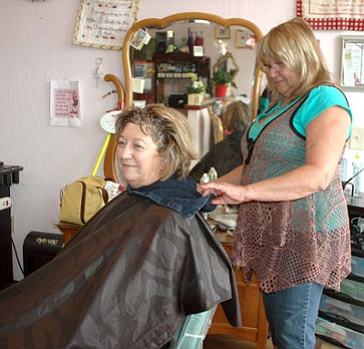 """Janet Shaw, a long-time patron, receives a color and cut at the hands of owner Valeri Reid-Little at Elite Reflections Salon and Day Spa in Prescott Valley. """"I've been coming here since 2000,"""" Shaw said.<br> Trib Photo/Briana Lonas"""