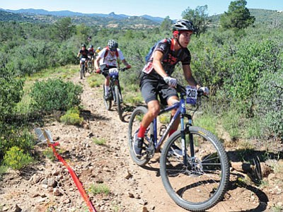 Bradshaw Mountain's Daniel Morales leads a large group of riders during the junior varsity opening race of the 2014 Arizona High School Cycling League's season Sunday on the Brownlow Trail system at Pioneer Park in Prescott.<br> Photo courtesy Les Stukenberg/The Daily Courier