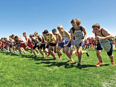 The number two and three boy runners from the 32 different attending schools hit the dirt during their start of the 42nd Annual Ray Wherley Invitational at Embry-Riddle Aeronautical University Sept. 13 afternoon in Prescott.<br> Matt Hinshaw/ Special to the Tribune