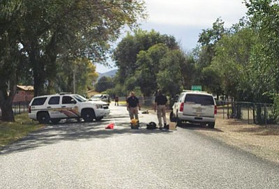 DPS officers investigate the scene of Friday's early-morning shooting.<br> Courtesy/YCSO