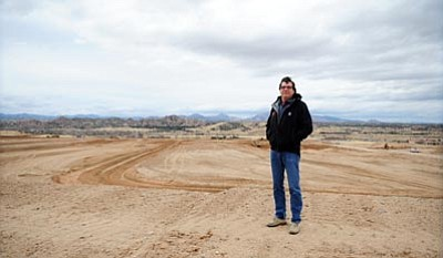 Les Stukenberg/The Daily Courier<br /><br /><!-- 1upcrlf2 -->Mike Fann stands on part of The Dells phase 1 that will have 208 residential lots and 18 acres of commercial property. Fann Contracting moved over 2 million yards of dirt to get the first phase ready for development. The total development will have 918 residential lots over 1100 acres with 300 acres of open space.