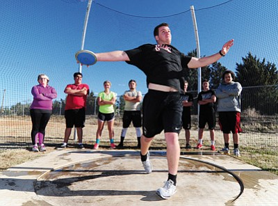 Les Stukenberg/The Daily Courier<br /><br /><!-- 1upcrlf2 -->John Trout launches the discus at Bradshaw Mountain track practice this past Wednesday in Prescott Valley.