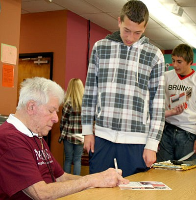 "Trib Photo/Sue Tone<br /><br /><!-- 1upcrlf2 -->Stephen Nasser, Holocaust survivor, signs his book for David Massis following his presentation Feb. 26 at Bradshaw Mountain Middle School. ""I never heard a survivor. I never heard the reality of it,"" David said."