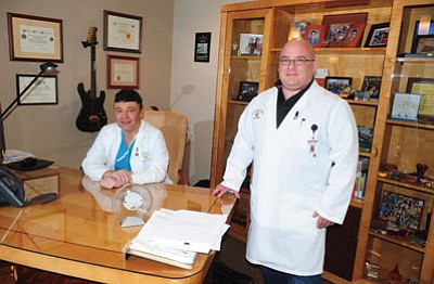 Yavapai Cardiac Surgery surgeons Dr. Pierre Tibi and Dr. Jose Torres in Dr. Tibi's Prescott office. (Les Stukenberg/The Daily Courier)