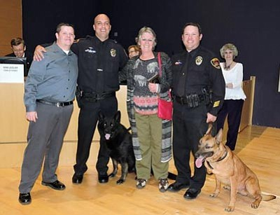 Left to right: Councilmember Stephen Marshall, PVPD Officer Paul Hines, Kio, Maryse Dunn, PVPD Officer David McNally and Jake help present the April Citizen of the Month award. (Courtesy Town of Prescott Valley)