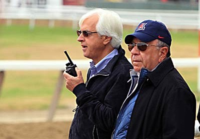 Garry Jones/The Associated Press<br /><br /><!-- 1upcrlf2 -->Hall of Fame trainer Bob Baffert, left, talks to his assistant via two-way radio as they wait for the track to be harrowed before bringing out American Pharoah at Belmont Park in Elmont, N.Y., Friday. At right is Bernie Sciappa. American Pharoah will try to become horse racing's 12th Triple Crown winner and first since Affirmed in 1978 when he runs in the Belmont Stakes today.