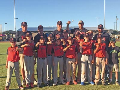 The Mudcats proudly wearing their championship rings; front row from left; Jacob Bannan; Seth Jelovic; Joey Sanchez; Connor Watson; Brady Olague; Thomas Bartels; Kaleb Burns; J.R. Willingham; Jacob Hogan; Riley Roskopf; Trever Stazenski and Bat Boy Blake Roskopf; and back row from left; Coaches Pete Jelovic; Jose Sanchez; Darren Bartels; Donny Roskopf and Tanner Stazenski. (Courtesy photo)
