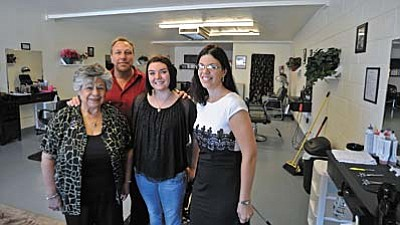 Matt Hinshaw/PNI<br /><br /><!-- 1upcrlf2 -->From right, Jennifer Graham, owner of Hair Benders Salon in Prescott Valley, stands with her staff from left, Irene Zamora, her husband John, and Sierra McGuire in their salon Wednesday morning. Hair Benders Salon opened their doors on June 1.