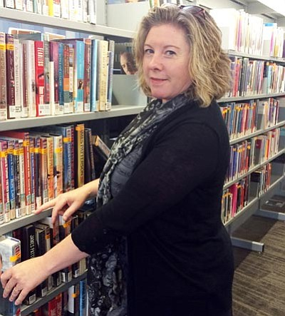 Adult Services Librarian Michele Hjorting has big plans for the library – beginning in September, the library will feature an exciting cultural series. (Trib Photo/Briana Lonas)